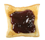 Toast with a red berry jam Stock Photos
