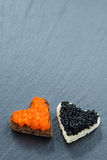 Toast with red and black caviar in the form of heart Royalty Free Stock Photo