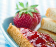 Toast with red strawberry jam Royalty Free Stock Photo