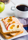 Toast with ricotta, apple, honey and dried fruits, coffee Stock Photos