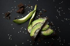 Toast with ripe avocado on a black table. Dietary food.  stock images