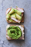 Toast with rose avocado and cheese and toast with shaved avocado and radishes Royalty Free Stock Images