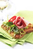 Toast with salami and ham. Slice of toasted bread with salami and ham royalty free stock photo