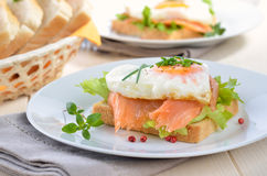 Toast with salmon. Toast with smoked salmon and heart shaped fried egg Stock Image