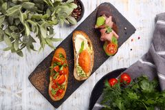 Toast with salmon, cheese, bacon Royalty Free Stock Images