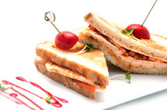 Toast sandwich with chicken, tomatoes and cheese on white plate, isolated on white background Stock Photos