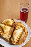 Toast sandwich. Made in a triangular press grilling royalty free stock images
