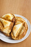 Toast sandwich. Made in a triangular press grilling royalty free stock photos