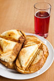 Toast sandwich. Made in a triangular press grilling royalty free stock photography