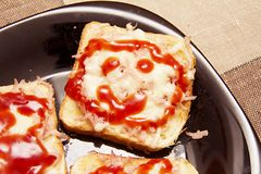Toast sandwich smile -ham, cheese, ketchup. Stock Images