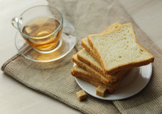 Toast on a saucer, sugar cubes and a cup of tea Stock Photography