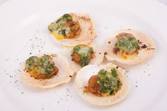 Toast scallops with cheese and spinach. On white background Stock Image