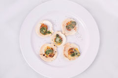 Toast scallops with cheese and spinach. On white background Stock Photo