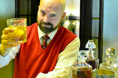 A toast with Scotch. A mature man toasts toward the camera stock photos