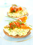 Toast with scrambled eggs,salmon and chives Royalty Free Stock Photography