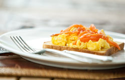 Toast with scrambled eggs and smoke salmon Stock Images