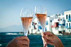 Toast by the sea. A romantic toast by the sea in Greece royalty free stock photo