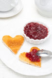 Toast in the shape of hearts and berry jam Stock Photo