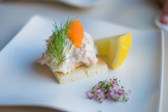 Toast Skagen shrimp sandwich on white table with citrus on the s Royalty Free Stock Photos