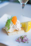 Toast Skagen shrimp sandwich on white table with citrus on the s Stock Image