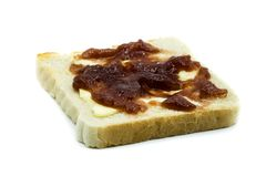 Toast slice with strawberry jam isolated on white background royalty free stock photo