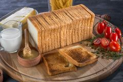 Toast sliced bread on wooden board Royalty Free Stock Photos
