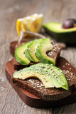 Toast with slices of avocado and spices Stock Photos