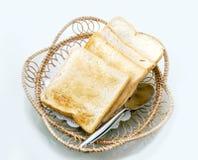 Toast slide whole wheat bread on rattan basket Stock Image