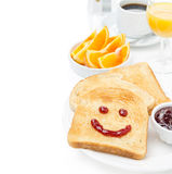 Toast with a smile of jam, coffee, orange juice and fresh orange Stock Photography