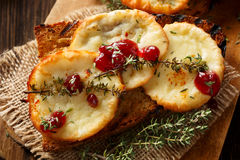 Toast with smoked cheese and wild red huckleberry jam Royalty Free Stock Images