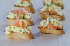 Toast with smoked salmon with scrambled eggs Stock Images