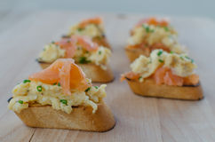 Toast with smoked salmon with scrambled eggs Stock Photography