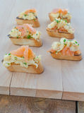Toast with smoked salmon with scrambled eggs Royalty Free Stock Photo