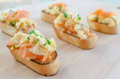 Toast with smoked salmon with scrambled eggs Royalty Free Stock Photography