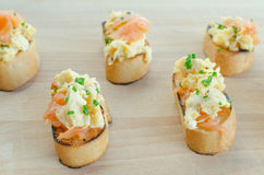 Toast with smoked salmon with scrambled eggs Stock Photos