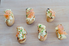Toast with smoked salmon with scrambled eggs Royalty Free Stock Images