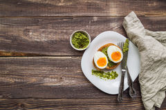 Toast with soft-boiled egg and pesto sauce Stock Images