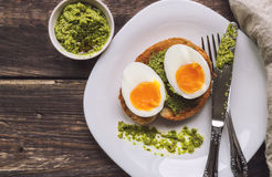 Toast with soft-boiled egg and pesto sauce Royalty Free Stock Image