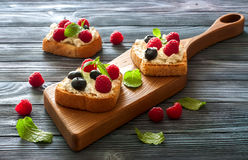Toast with soft cheese and berries Stock Photography
