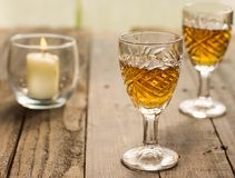 Toast. A soft romantic setting with 2 glasses of liquor Stock Image