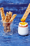 Toast soldiers dipped in boiled egg Stock Photo