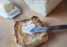 Toast spread with butter Royalty Free Stock Photo