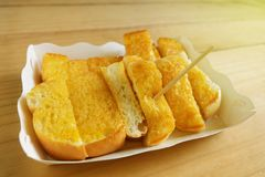 Toast Spread Margarine put Sweetened condensed milk. On a plate of paper Stock Photo