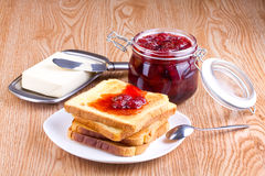 Toast with strawberry jam Royalty Free Stock Images