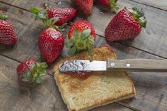 Toast and strawberry jam Stock Image