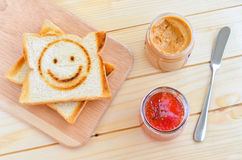 Toast with strawberry jam and peanut butter Royalty Free Stock Photography