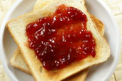 Toast. With strawberry jam on plate royalty free stock image