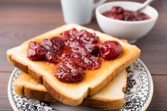 Toast with strawberry jam Royalty Free Stock Image