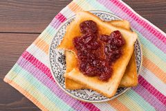 Toast with strawberry jam Stock Image