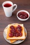 Toast with strawberry jam Stock Image